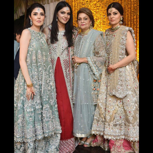 Saira and family decked out in Saira Shakira designs at the designers brothers mehndi