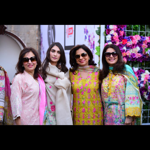 Farah Talib Aziz and Imaan Madani with guests
