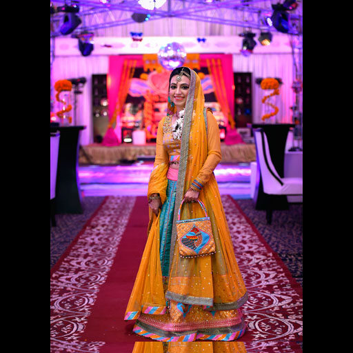 Nida Iqbal wearing a festive truck art theme lehnga choli by Yasmin Zaman