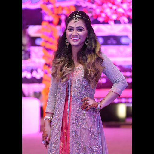 Nazia wearing a Yasmin Zaman formal