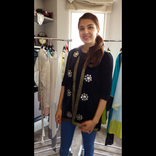 Ayesha Mustafa of Fashion Compassion trying on her new Sana T jacket
