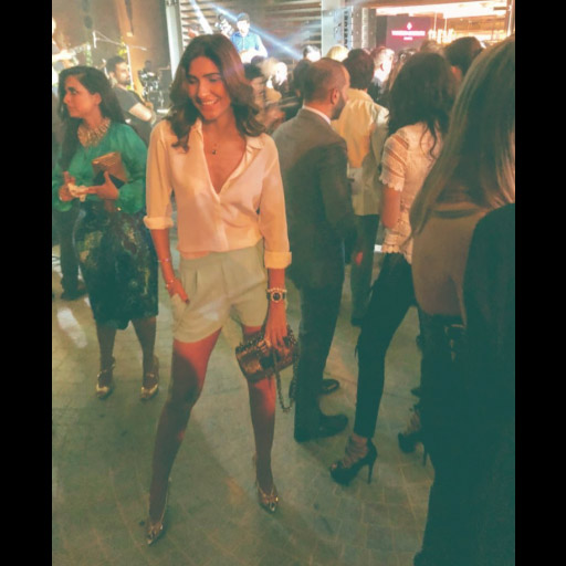 Kiran Malik looks casual chic in a lose white top and shorts while out and about in Dubai.