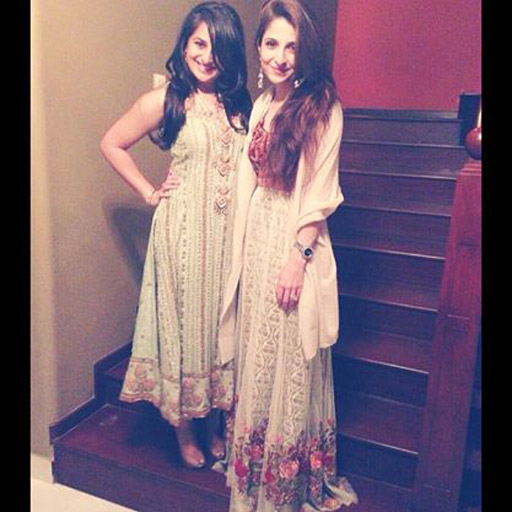 Tena Durrani (right) wears her own design, a maroon velvet choli with a white net and gold screen print lehnga