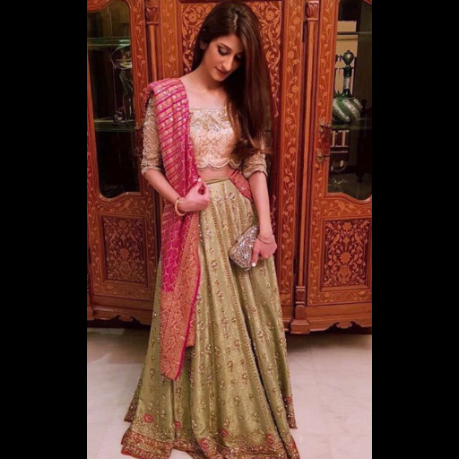 Alishay Adnan in a kiwi green FTA lehnga and rose pink choli.
