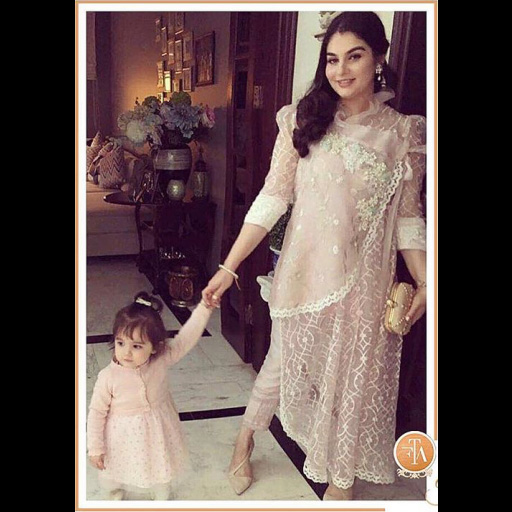Abeer Ghani in a pastel pink luxe pret outfit.