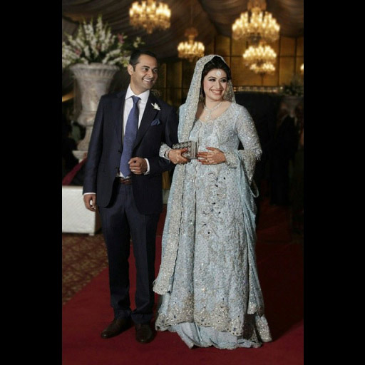 Amna looking beautiful on her reception in a powder blue bridal gown encrusted with pearls, Swarovski crystals and 'vasli' embroidery.