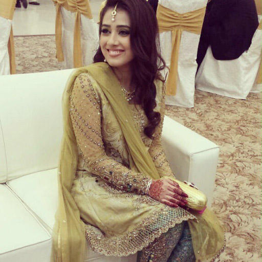 Maryam looking radiant at her Nikah Reception in a delicately worked Gold and Emerald creation.