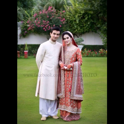 Batool Asif in a red and peach traditional bridal