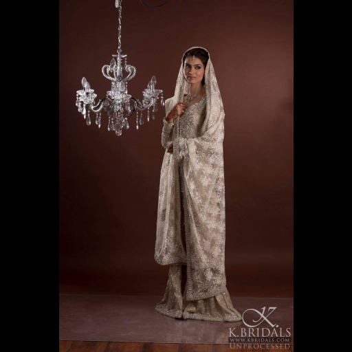 Fatima Hasan in an Ivory net bridal on her Valima