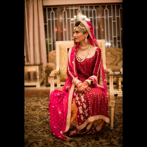 Fatima Hasan in deep red classic bridal