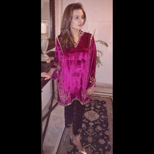 Momal Sheikh in a velvet embellished kurta in bold shades of magenta
