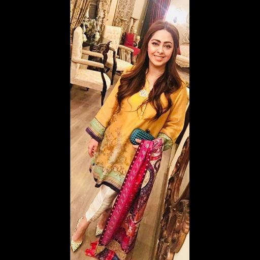 Makeup artist Mariam Khawaja stuns in a festive yellow Sania Maskatiya shirt