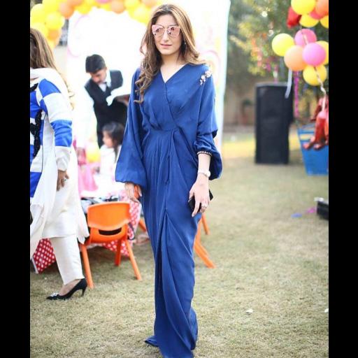 Hajira Asfandyar looks fabulous in a deep blue Sania Maskatiya kaftan at her daughters birthday