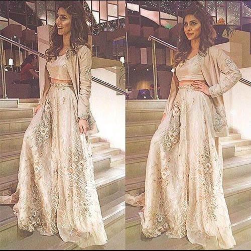 Uzma Khan in aTena Durrani statement jacket paired with crop top and lehnga