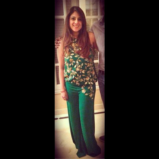Rabia Kramet Rizvi in a heavy embellished emerald MAHEENKARIM evening jumpsuit