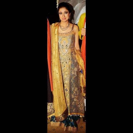 Nazafreen S. Lakhani in a cut-work masterpiece by Ammara Khan. Gold Lame' 'dupatta' and brocade 'lehnga' complete the ensemble