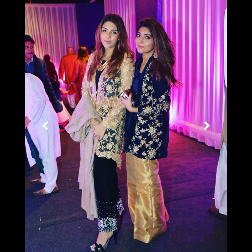 Sara Wassan in a velvet navy blue jacket(right)