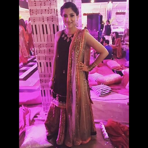 Natasha in a luxe velvet Misha Lakhani formal