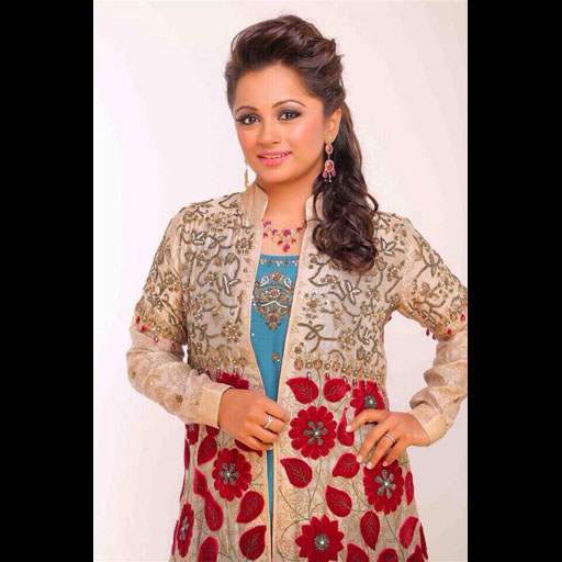 Spotted in Momina Teli formal red floral bud and embellished jacket on teal