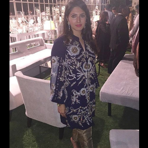 Ayesha Dawood in a Momina Teli handworked silver gold formal