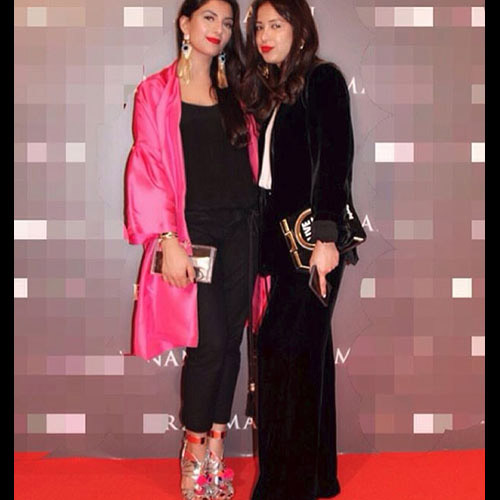 Meher Tareen (left) in a MuseLuxe Jacket and Sophia Webster heels