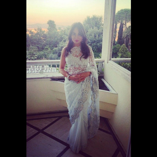 Beautiful artist Faiza Sheikh wears a custom-designed powder blue lace Sari to a wedding