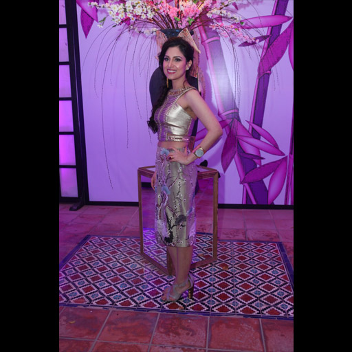 Aale Mowji in a glamorous custom Shehla Chatoor gold handweave leather crop top and Misaki skirt
