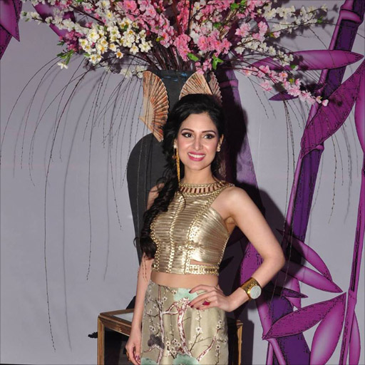 Aale wearing a Shehla Chatoor jade cuff to accessorize her Misaki outfit