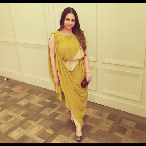 Amna Hassan Tahir in an Umaima Mustafa yellow draped dress