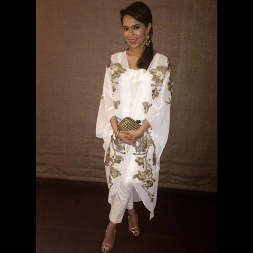 Hina Rashid in an Umaima Mustafa white and gold Cape