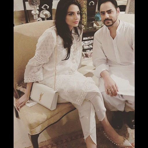 Amna Irfan wears a pristine white ensemble paired with maison valentino nude pumps and a ysl cross body