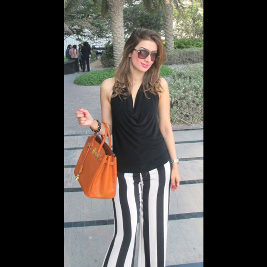Nadia in chic street style sporting striped Pants from Impulse at Macys NYC, Halter vintage black top, and Hermes Birkin